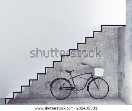 retro bicycle with basket in front of the interior concrete wall, background - stock photo