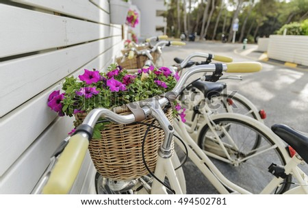 Retro bikes with baskets and flowers