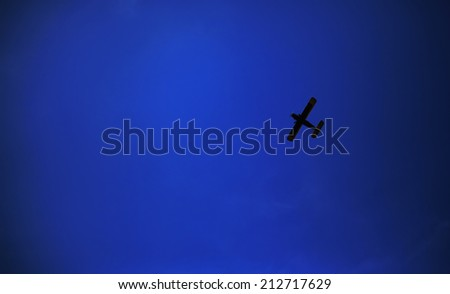 Retro-biplane aircraft, against the blue sky - stock photo