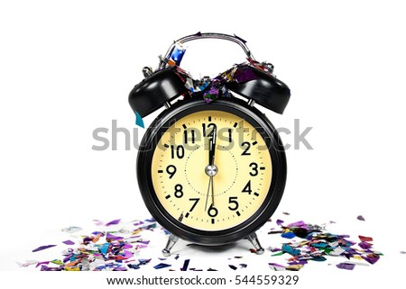 retro black New Years clock with party confetti on white