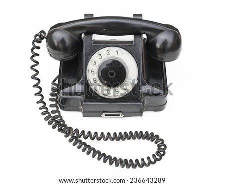Retro black telephone on white background from the Soviet Union - stock photo