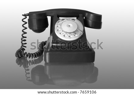 retro black telephone with reflection
