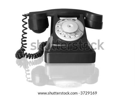 retro black telephone with reflection isolated on white - stock photo