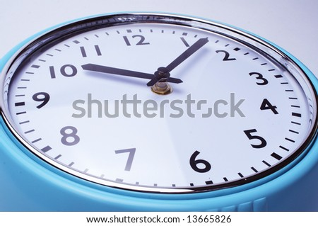 retro blue and white clock on white background