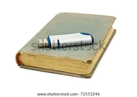 Retro book and flash memory isolated on white background - stock photo