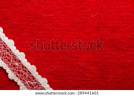 Retro border for invitations celebration. Vintage white lace over red textile background. - stock photo