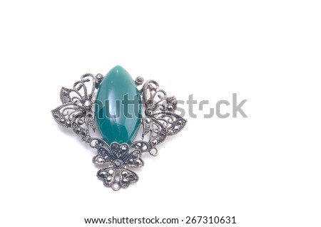 retro brooch with green gems isolated - stock photo