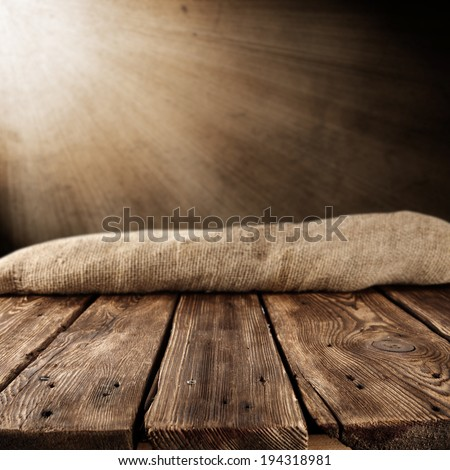 retro brown table with wall of light of lamp and sack  - stock photo