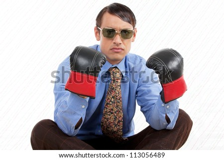 Retro business man wearing boxing gloves