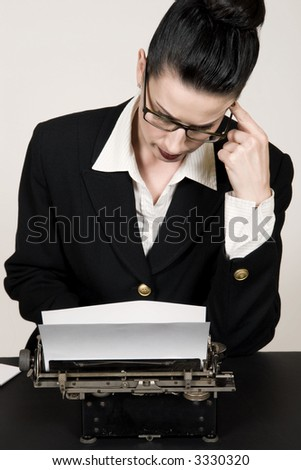 Retro business woman with vintage typewriter - stock photo