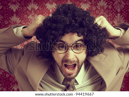 Retro businessman who reacts badly to stress