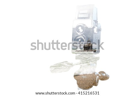 Retro camera and seascape, double exposure - stock photo