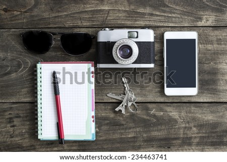 Retro camera and various personal items. Overhead view. - stock photo
