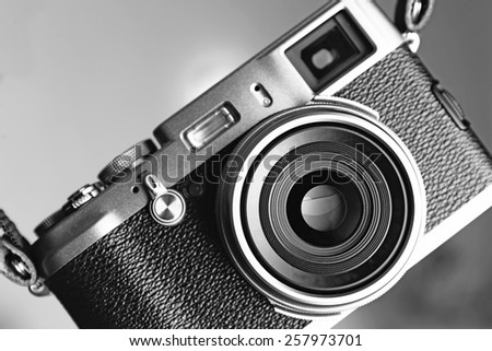Retro camera in shades of grey, closeup - stock photo