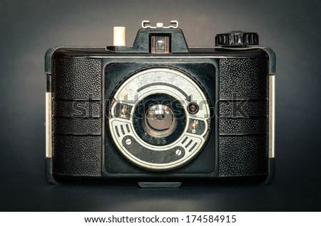 retro camera on black background with vignette - stock photo