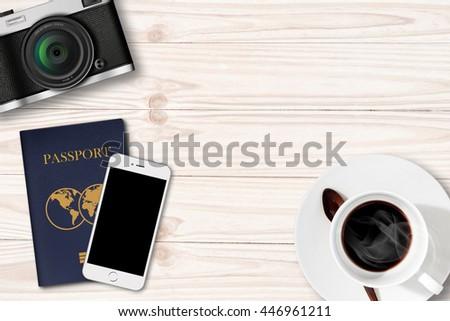 Retro camera,Smartphone and passport on Coffee Table - stock photo