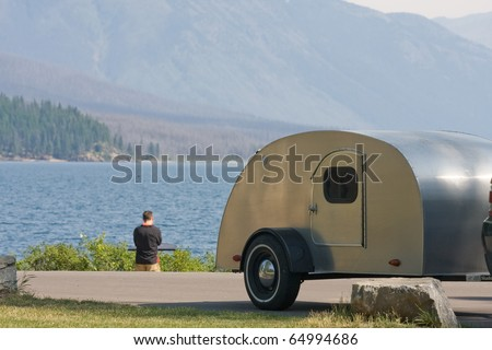 Retro camping scene at Glacier NP - stock photo