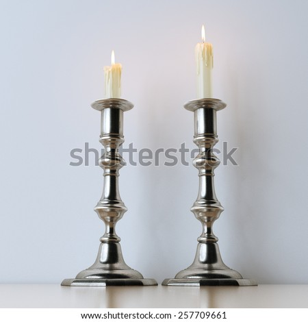 Retro candelabra with burning candles on wooden surface  - stock photo