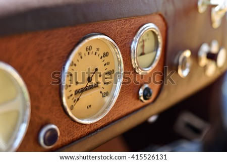 Retro car dashboard with gauges - stock photo