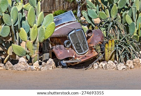 Retro car is stuck in a thicket of cactus Namib desert - Namibia, Africa