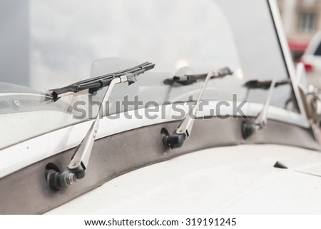 Retro car windshield with windshield wipers. Three wipers - stock photo