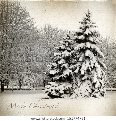 Retro card with Merry Christmas, trees and Christmas trees in snow winter landscape - stock photo