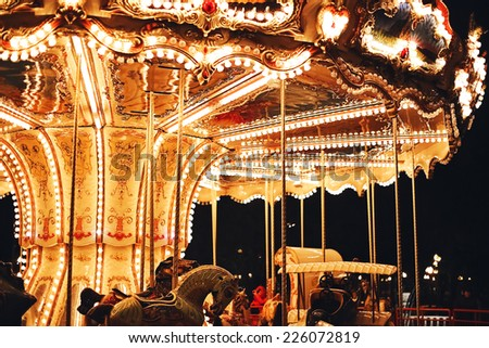 retro carousel at night - stock photo