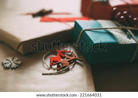 Retro Christmas gifts box presents on brown paper - stock photo