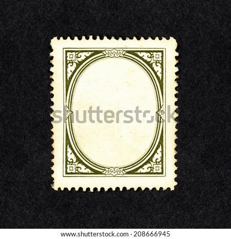 Retro classic green vine ornate border in the frame of a vintage postage stamp, with blank space for text. - stock photo
