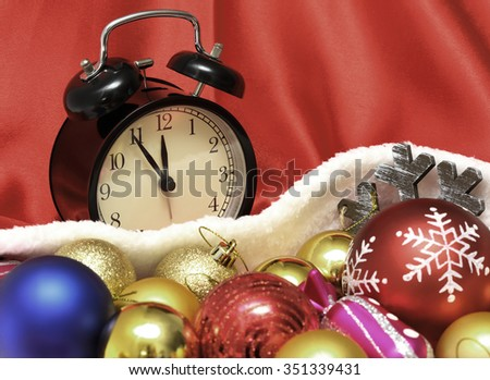 Retro clock and christmas balls and toys in a red bag - stock photo