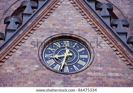 retro clock dial on historical church wall