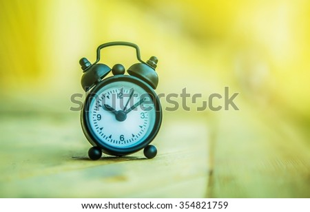 Retro clock selective focus and The sunlight in the morning - stock photo