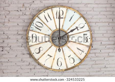 Retro clock showing twelve oclock on the wall - stock photo
