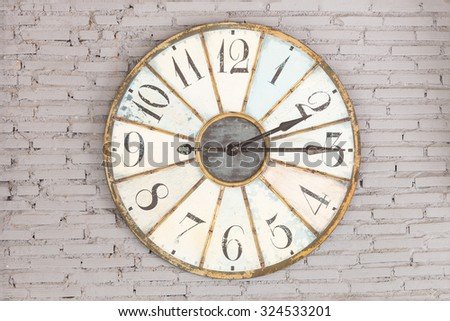 Retro clock showing two fifteen on the wall - stock photo