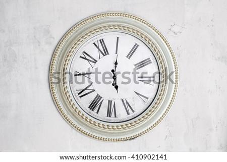 Retro clocks on the white wall close up - stock photo