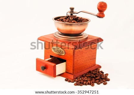 Retro coffee mill and grains on white background - stock photo