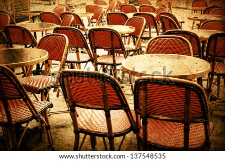 Retro coffee terrace with tables and chairs,paris France