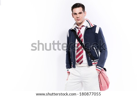 Retro college boy fashion wearing red tie and blue jacket. Studio shot against white. - stock photo