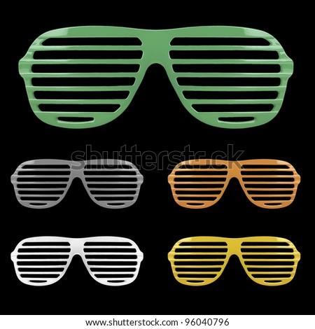 Retro colorful shades sunglasses isolated on black background - stock photo