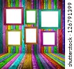 Retro colorful wood room with multicolored photo frames - stock photo