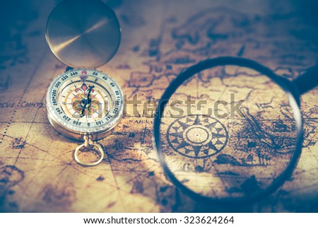Retro compass on ancient world map stock photo royalty free retro compass on ancient world map dark vintage style gumiabroncs Gallery