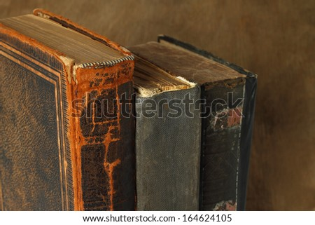 Retro composition with books on wooden background - stock photo