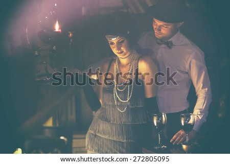 Retro couple.Couple with glasses of red wine in restaurant.Fashion,retro, vintage, tones.Retro couple.Couple with glasses of red wine in restaurant.Fashion,retro, vintage, tones. Antique picture . - stock photo