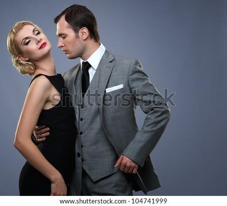 Retro couple isolated on grey background - stock photo