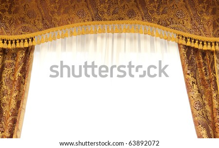 Retro curtains with top panel and gold tassel - stock photo