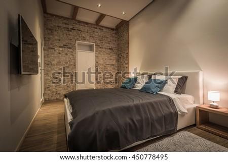 retro designed bedroom with brick wall