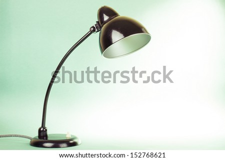 Retro desk lamp on gradient mint green and white background - stock photo