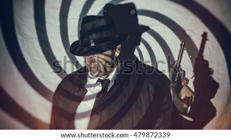 Retro Detective Spy With Gun Swirl. Man in white shirt, black tie and hat standing holding gun in shadows of swirl pattern, in film noir style. Edited with vintage film effects.