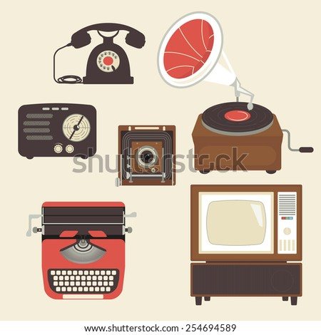 Retro devices collection of tv, radio, gamepad, audio cassette, mobile phone, typewriter and pc - stock photo