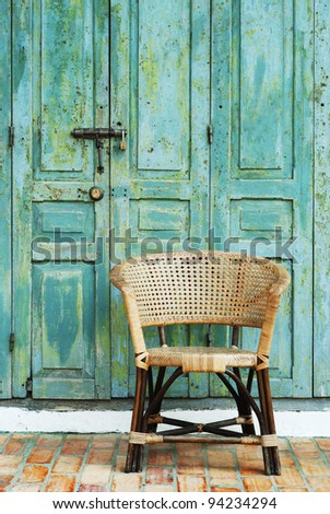 retro door and chair in old town - stock photo